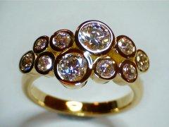 Custom-pge-18ct-yellow-gold-with-ten-bezel-set-diamonds.jpg