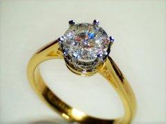 1.56ct_round_brilliant_cut_in_classic_pierced_setting.jpg