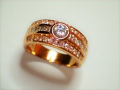 18ct_rose_gold_with_bezel_bead_and_chanel_set_diamonds.jpg