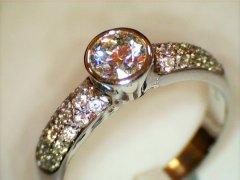 Bezel_set_round_brilliant_cut_with_pave_shoulder_diamonds.jpg