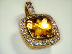 Citrine_enhancer_with_diamond_set_bale_and_halo_in_18ct_yellow_gold.jpg