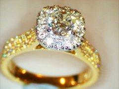 Cushion_cut_1.03ct_with_halo__and_triple_row_shoulder_diamonds.jpg