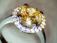 Fancy_yellow_diamond_1.60ct_in_platinum_halo.jpg