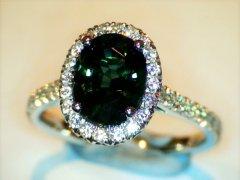 Green_sapphire_in_diamond_platinum_halo.jpg