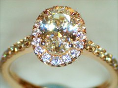 Oval_0.76ct_with_halo_18ct_rose_gold.jpg