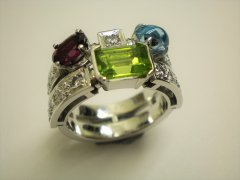 Peridot_garnet_topaz_and_diamond_ring.JPG