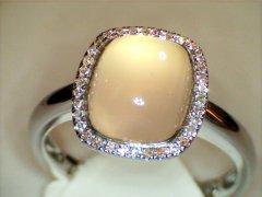 Rose_quartz_and_diamond_halo_in_white_gold.jpg