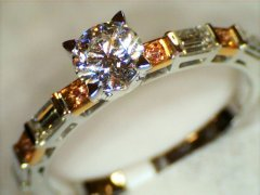 Round_brilliant_cut_pink_diamonds_in_shoulders.jpg